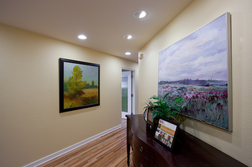 Corridor with art-Sherman Sherman Johnnie & Hoyt, LLP